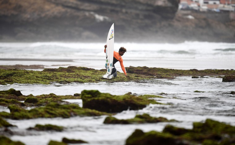 A surfer arrives for the Round 1 on May 23, 2027 in Biarritz, southwestern France, during the 2017 ISA World Surfing Games. The event runs until May 28. (Franck Fife/AFP/Getty Images)