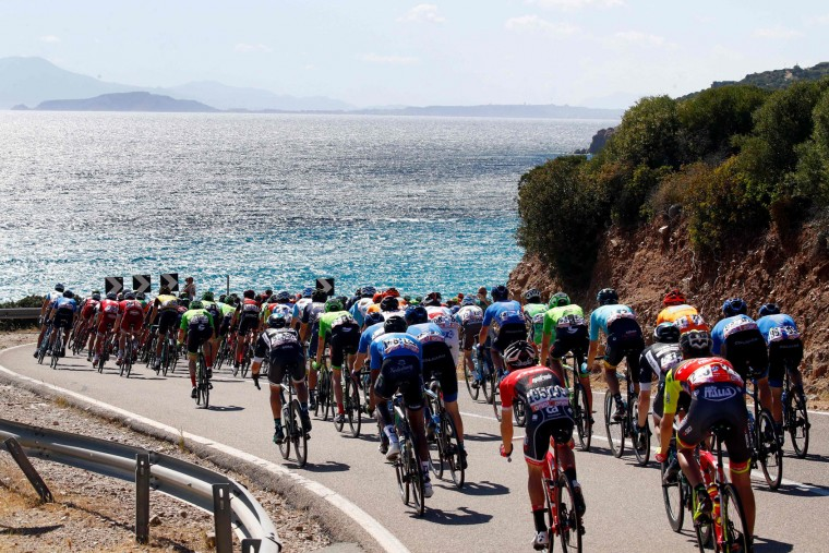 The peloton rides during the third stage of the 100th Giro d'Italia, Tour of Italy, cycling race from Tortoli to Cagliari on May 7, 2017 in Sardinia. Colombian sprinter Fernando Gaviria finished off a cunning tactical move by his Quick Step team to win the third stage of the Giro d'Italia and secure the race leader's pink jersey on Sunday. (Luk Benies/AFP/Getty Images)