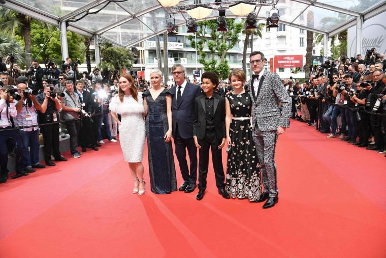 (From L) US actress Julianne Moore, US actress Michelle Williams, US director Todd Haynes, US actor Jaden Michael, US actress Millicent Simmonds and US writer/screenwriter Brian Selznick pose as they arrive on May 18, 2017 for the screening of their film 'Wonderstruck' at the 70th edition of the Cannes Film Festival in Cannes, southern France. (Alberto Pizzoli/AFP/Getty Images)