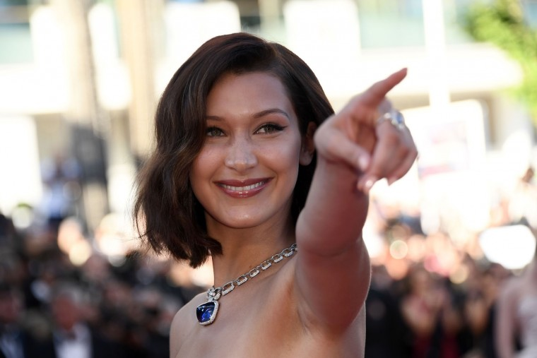 US model Bella Hadid poses as she arrives on May 17, 2017 for the screening of the film 'Ismael's Ghosts' (Les Fantomes d'Ismael) during the opening ceremony of the 70th edition of the Cannes Film Festival in Cannes, southern France. (Anne-Christine Poujoulat/AFP/Getty Images)