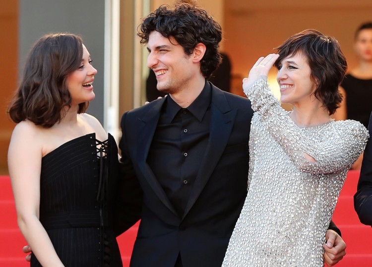 (From L) French actress Marion Cotillard, French actor Louis Garrel and French actress Charlotte Gainsbourg pose as they arrive on May 17, 2017 for the screening of their film 'Ismael's Ghosts' (Les Fantomes d'Ismael) during the opening ceremony of the 70th edition of the Cannes Film Festival in Cannes, southern France. (Valery Hache/AFP/Getty Images)
