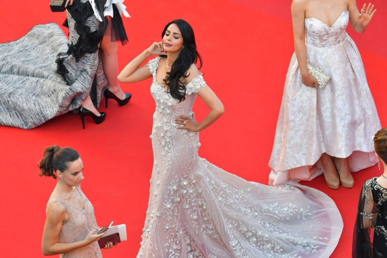 Indian actress Malika Sherawat poses as she arrives on May 17, 2017 for the screening of the film 'Ismael's Ghosts' (Les Fantomes d'Ismael) during the opening ceremony of the 70th edition of the Cannes Film Festival in Cannes, southern France. (Loic Venance/AFP/Getty Images)