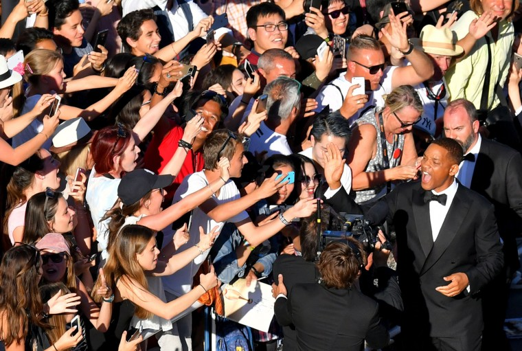 US actor and member of the Feature Film jury Will Smith poses for selfies as he arrives on May 17, 2017 for the screening of the film 'Ismael's Ghosts' (Les Fantomes d'Ismael) during the opening ceremony of the 70th edition of the Cannes Film Festival in Cannes, southern France. (Loic Venance/AFP/Getty Images)