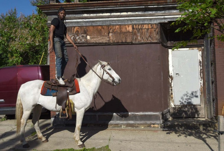 Philadelphia horseman Chris Coger goes for a evening ride in the streets of Philadelphia on May 16, 2017. (TIMOTHY A. CLARY/AFP/Getty Images)