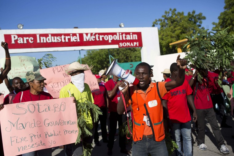 Workers chant anti-government slogans outside Industrial Park during a demonstration marking International Labor Day in Port-au-Prince, Haiti, Monday, May 1, 2017. (AP Photo/Dieu Nalio Chery)