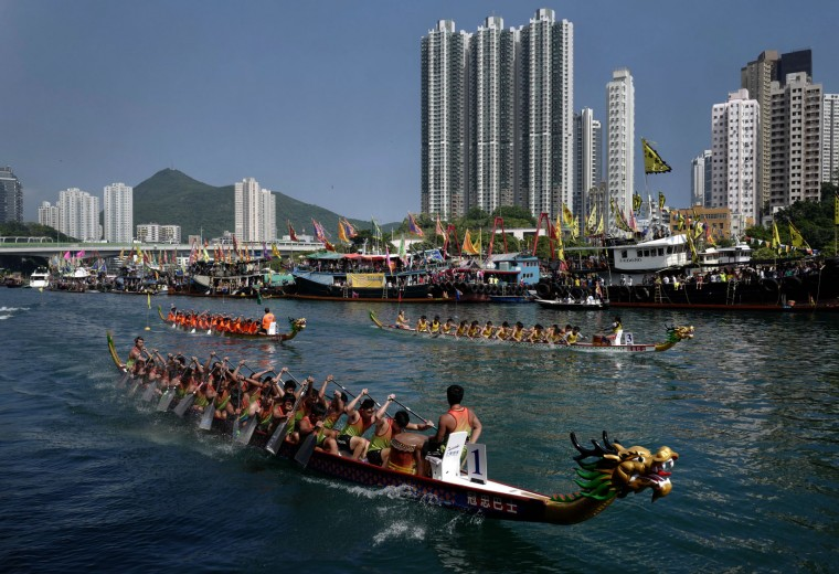 Participants compete in a dragon boat race in Hong Kong, Tuesday, May 30, 2017, as part of celebrations marking the Chinese Dragon Boat Festival, held throughout Hong Kong. (AP Photo/Vincent Yu)