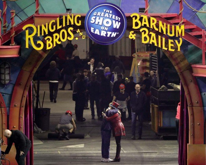 "In this May 7, 2017 file photo, Ringling Bros. and Barnum & Bailey Circus ringmaster Kristen Michelle Wilson, center right, hugs a member of the crew after the circus' red unit gave its final performance in Providence, R.I. The circus that has wowed crowds for 146 years with its ""Greatest Show on Earth"" will be taking its final bow on Sunday May 21, 2017, when the sold-out 7pm show finishes at the Nassau County Coliseum in Uniondale, New York. (AP Photo/Julie Jacobson, File)"