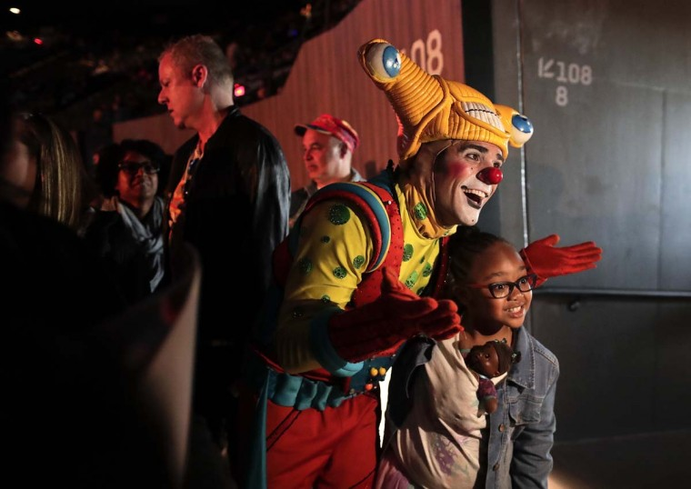 A clown poses for a photo with a child during the pre-show for the final performance of the Ringling Bros. and Barnum & Bailey Circus, Sunday, May 21, 2017, in Uniondale, N.Y. (AP Photo/Julie Jacobson)