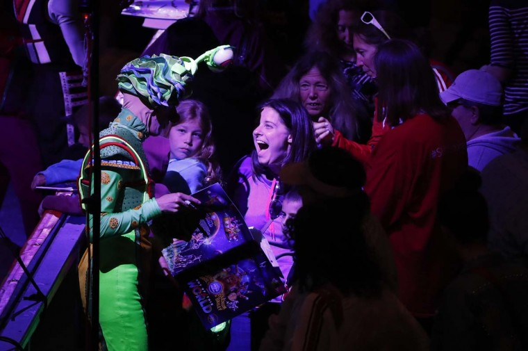 A member of the audience reacts as she talks with a clown during the pre-show for the Ringling Bros. and Barnum & Bailey Circus Out of This World show before the circus' final performance, Sunday, May 21, 2017, in Uniondale, N.Y. (AP Photo/Julie Jacobson)