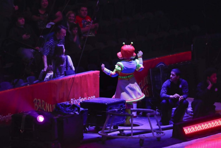 A clown entertains members of the audience during the pre-show for the final performance of the Ringling Bros. and Barnum & Bailey Circus, Sunday, May 21, 2017, in Uniondale, N.Y. (AP Photo/Julie Jacobson)