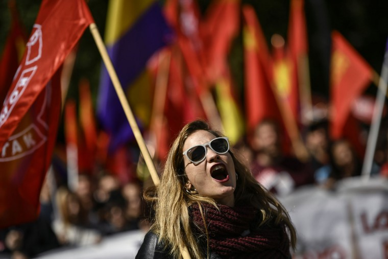 Trade Union demonstrator shouts slogans during a May Day rally in Pamplona, northern Spain, Spain, Monday, May 1, 2017. The country's two major unions called for marches in over 70 cities to demanded that the conservative government roll back its labor reforms to make it cheaper to fire workers and increase wages and government pensions as Spain emerges from its recent economic downturn. (AP Photo/Alvaro Barrientos)