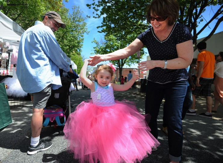 Towson, Md--5/4/13--Eden Gair, 3, Halethorpe, shows off her new dress purchased by her grandparents, Matt Davis and Debbie Collins, Towson. They bought the pink creation in the Iva's Handmade Creations booth at the Towsontown Spring Festival. Kim Hairston/Baltimore Sun Staff.