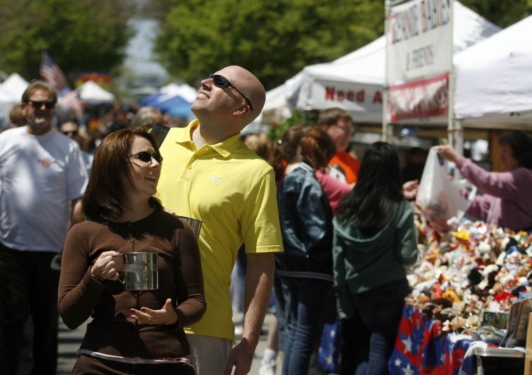 Staff photo by Kitty R Charlton (L-R) Kelly Jackson, of Towson, and Todd Eicker, of Red Lion, Pa., take in the sights and sounds of the Towsontown Spring Festival, Saturday, April 30.