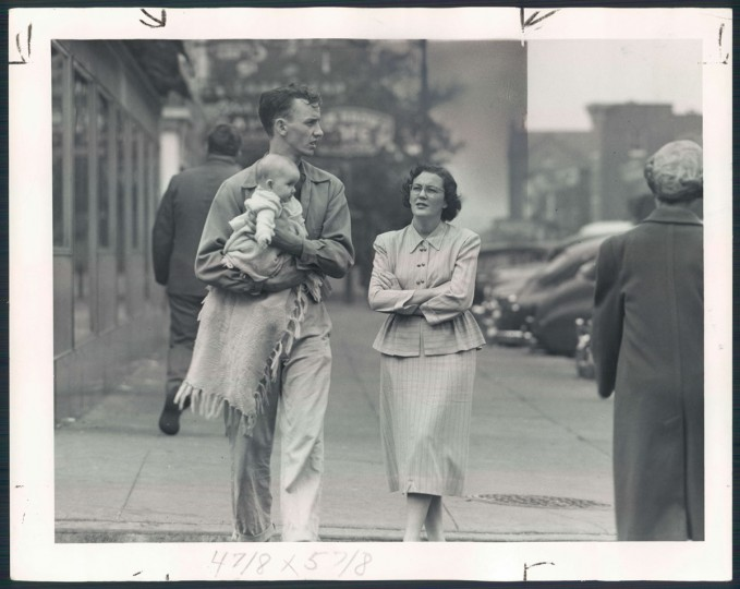 "October 22, 1950 - SUCH IS LIFE IN BALTIMORE - Highlandtown -- Some serious problem apparently was getting this couple's consideration, but the baby was just ""out for the ride,"" with never a cry. (Hans Marx/Baltimore Sun)"