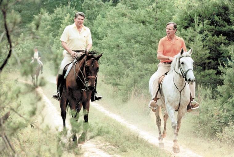 Undated photo of George Bush and Ronald Reagan horseback riding at Camp David. (Baltimore Sun archives)