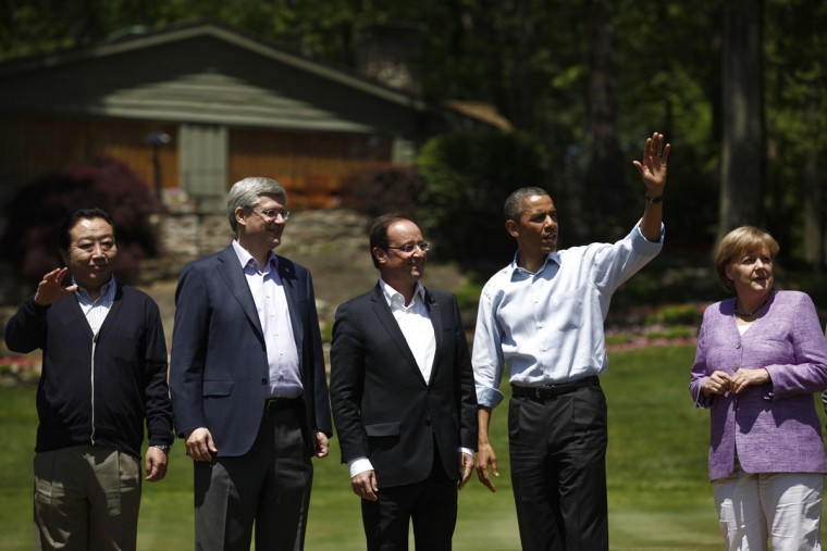 Japanese Prime Minister Yoshihiko Noda, Canadian Prime Minister Stephen Harper, French President Francois Hollande, U.S. President Barack Obama and German Chancellor Angela Merkel pose for a family photo during the 2012 G8 Summit at Camp David May 19, 2012 in Camp David, Maryland. (Photo by Luke Sharrett/ The New York Times-Pool/Getty Images)