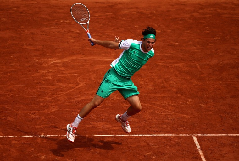 Dominic Thiem of Austria in action during men's singles quarter finals match against Novak Djokovic of Serbia on day eleven of the 2017 French Open at Roland Garros on June 7, 2017 in Paris, France. (Photo by Julian Finney/Getty Images)