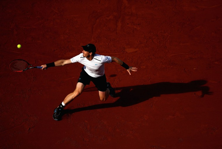Andy Murray of Great Britain plays a backhand during men's singles quarter finals match against Kei Nishikori of Japan on day eleven of the 2017 French Open at Roland Garros on June 7, 2017 in Paris, France. (Photo by Julian Finney/Getty Images)