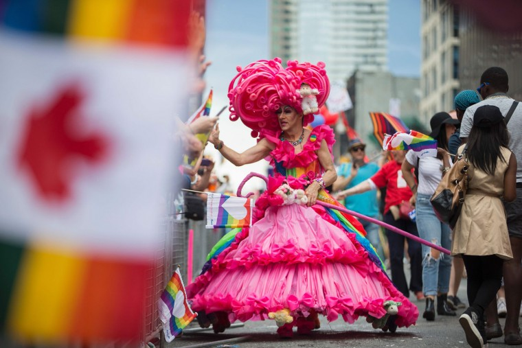 A drag queen high five's spectators during the Pride Parade in Toronto, Ontario, June 25, 2017. The event draws hundreds of thousands of spectators every year. (Geoff Robins/AFP/Getty Images)