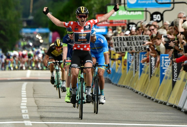 Netherlands' Koen Bouwman second best climber's polka dot jersey, celebrates as he crosses the finish line during the 184 km third stage of the 69th edition of the Criterium du Dauphine cycling race on June 6, 2017 between Le Chambon-sur-Lignon and Tullins. (Philippe Lopze/AFP/Getty Images)