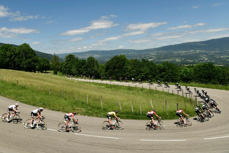 Belgium's Thomas De Gendt (C), wearing the overall leader's yellow jersey, rides in the pack during the 147,5 km sixth stage of the 69th edition of the Criterium du Dauphine cycling race on June 9, 2017 between Villars-les-Dombes and La Motte-Servolex. (Philippe Lopze/AFP/Getty Images)