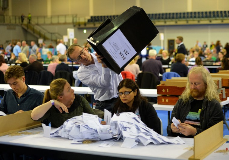 GLASGOW, SCOTLAND - JUNE 08: Ballot papers are counted during the UK Parliamentary Elections at the Emirates Arena on June 8, 2017 in Glasgow, Scotland. After a snap election was called, the United Kingdom went to the polls yesterday following a closely fought election. The results from across the country are being counted and an overall result is expected in the early hours. (Photo by Mark Runnacles/Getty Images)