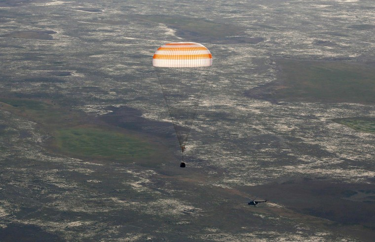 The Soyuz MS-03 space capsule carrying the International Space Station (ISS) crew of Russian cosmonaut Oleg Novitskiy and French astronaut Thomas Pesquet descends beneath a parachute just before landing in a remote area outside the town of Dzhezkazgan (Zhezkazgan), Kazakhstan, on June 2, 2017. (Pool/Shamil Zhumatov/AFP/Getty Images)