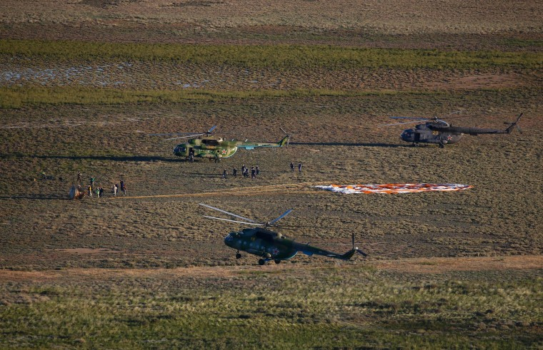 Search and rescue team approaches the Soyuz MS-03 space capsule carrying the International Space Station (ISS) crew of Russian cosmonaut Oleg Novitskiy and French astronaut Thomas Pesquet after its landing in a remote area outside the town of Dzhezkazgan (Zhezkazgan), Kazakhstan, on June 2, 2017. (Pool/Shamil Zhumatov/AFP/Getty Images)