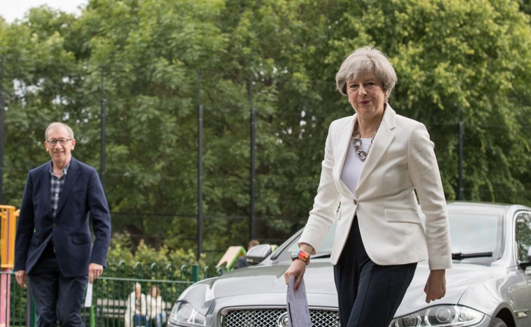 MAIDENHEAD, ENGLAND - JUNE 08: Conservative Party leader Theresa May and husband Philip arrive at the polling station in Sonning Guide & Scout hut after casting their vote on June 8, 2017 in Sonning near Maidenhead, England. Polling stations have opened as the nation votes to decide the next UK government in a general election. (Photo by Matt Cardy/Getty Images)