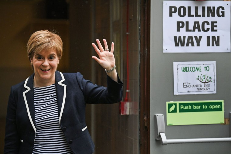 GLASGOW, SCOTLAND - JUNE 08: SNP Leader Nicola Sturgeon exits after casting her vote in the general election with her husband Peter Murrel at Broomhouse Community Hall on June 8, 2017 in Glasgow, Scotland.Millions of people across the UK will cast their votes in the 2017 general election. (Photo by Jeff J Mitchell/Getty Images)