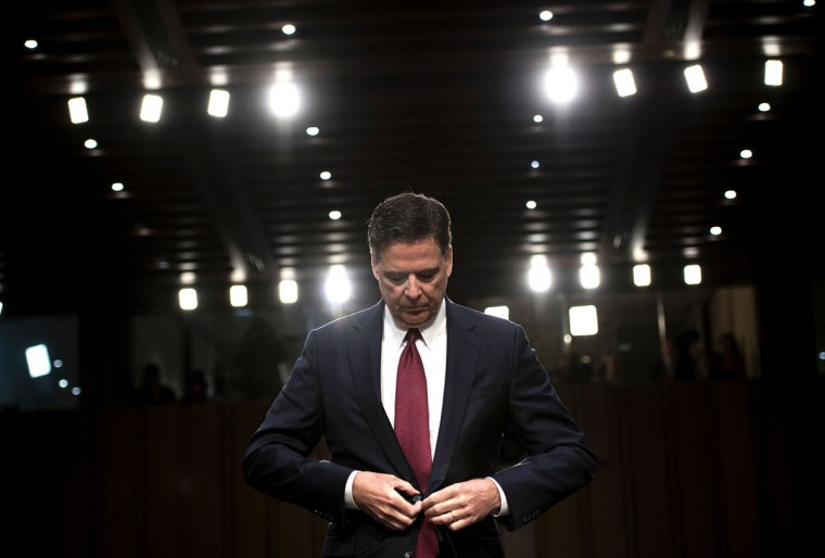 Ousted FBI director James Comey listens during a hearing before the Senate Select Committee on Intelligence on Capitol Hill June 8, 2017 in Washington, DC.Fired FBI director James Comey took the stand Thursday in a crucial Senate hearing, repeating explosive allegations that President Donald Trump badgered him over the highly sensitive investigation Russia's meddling in the 2016 election. / (AFP Photo/Brendan Smialowski)