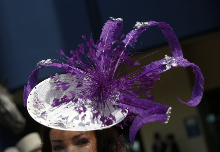 A racegoer wears an ornate hat as she arrives for the first day of the Royal Ascot horse race meeting in Ascot, England, Tuesday, June 20, 2017. (AP Photo/Alastair Grant)