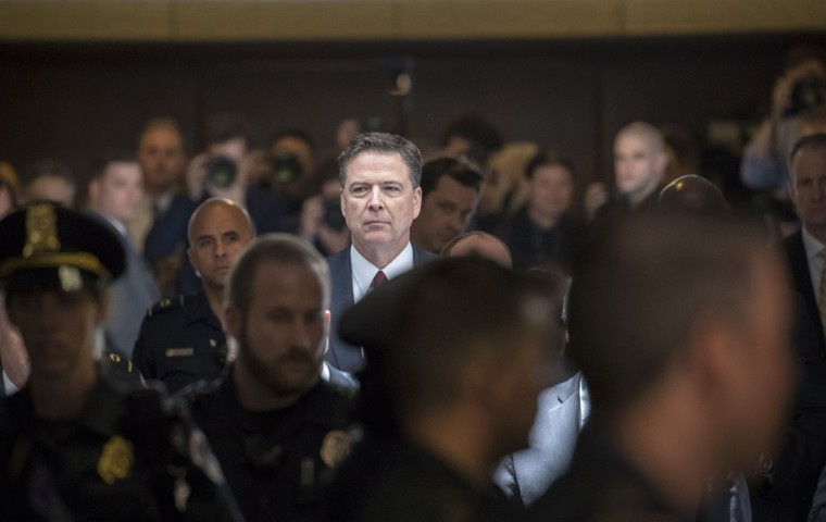"Former FBI director James Comey walks through a corridor on the way to a secure room to continue his testimony to the Senate Select Committee on Intelligence, on Capitol Hill in Washington, Thursday, June 8, 2017. Comey, who was fired by President Donald Trump, told the panel in open session that Trump repeatedly pressed him for his ""loyalty"" and directly pushed him to ""lift the cloud"" of investigation by declaring publicly the president was not the target of the probe into his campaign's Russia ties. (AP Photo/J. Scott Applewhite)"