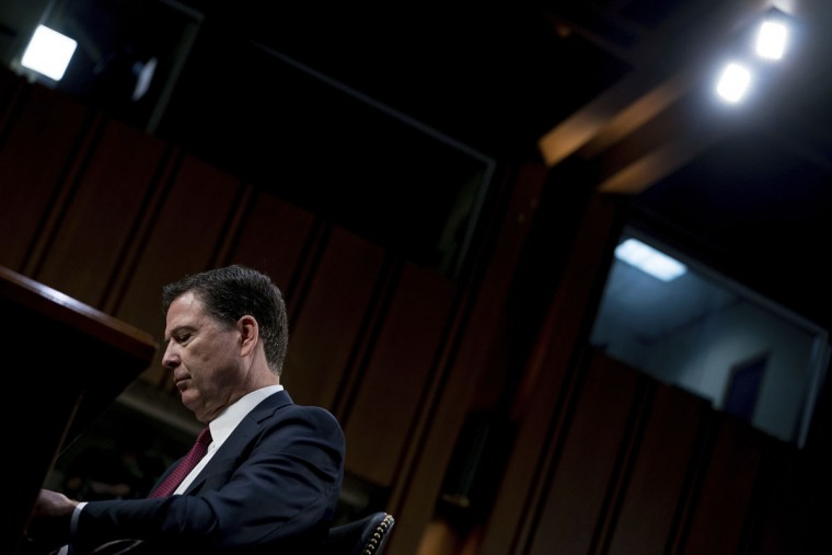 Former FBI Director James Comey pauses during a Senate Intelligence Committee hearing on Capitol Hill, Thursday, June 8, 2017, in Washington. (AP Photo/Andrew Harnik)