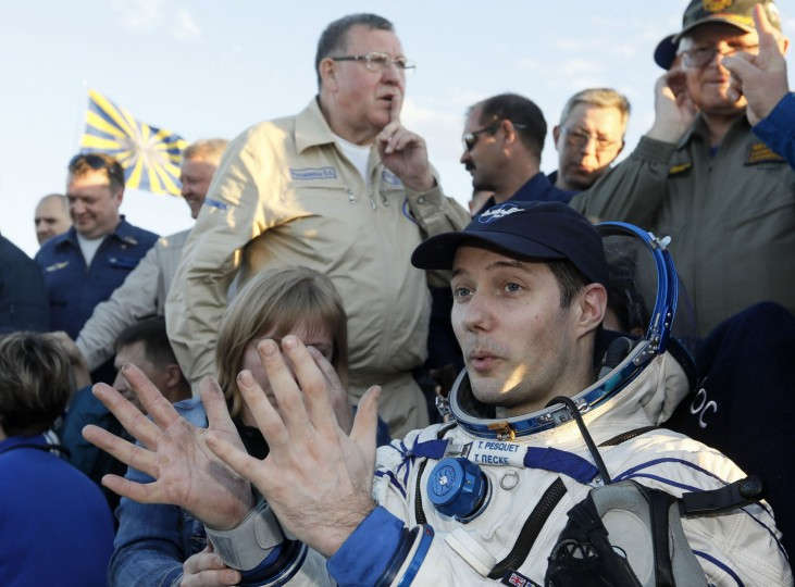 International Space Station crew member, French astronaut Thomas Pesquet, gestures after landing in a remote area outside the town of Dzhezkazgan, Kazakhstan, Friday, June 2, 2017. The capsule with Russian cosmonaut Oleg Novitsky and French astronaut Thomas Pesquet, landed Friday on the steppes of Kazakhstan. (Shamil Zhumatov/Pool Photo via AP)