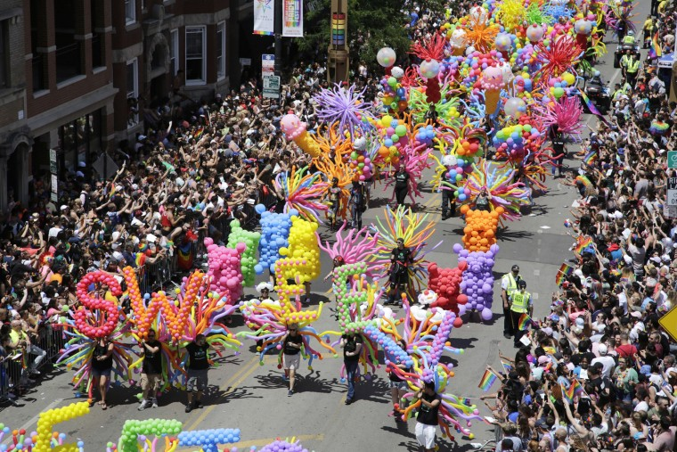 Crowds line the street as they watch the Chicago Pride Parade, Sunday, June 25, 2017. (AP Photo/G-Jun Yam)