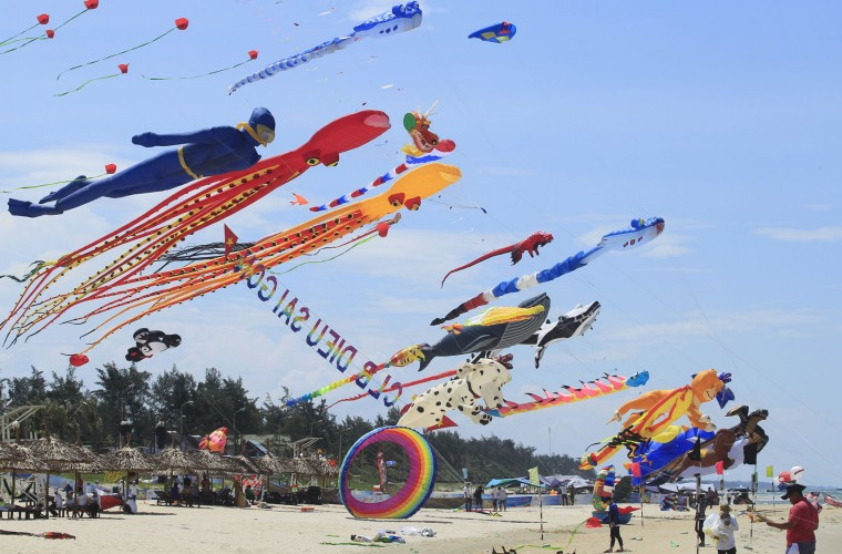 In this Sunday, June 11, 2017, photo, colorful kites are flown in the sky on Tam Thanh beach during an International Kite Festival in Quang Nam province, Vietnam. Hundreds of flying giant sea creatures, animal shaped and folklore inspired kites from 20 countries were taken to the sky. (AP Photo/Hau Dinh)