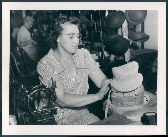 A woman makes a hat in a Baltimore factory, undated photo. (Baltimore Sun archives)