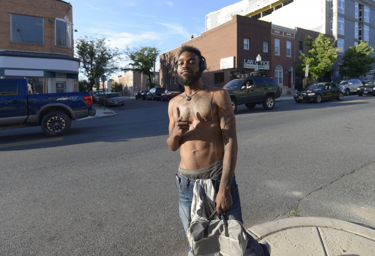 """I just got down here and I do not wanna be anywhere else,"" said Sam Green, a barber and artist. ""It's way more relaxing"" than other neighborhoods, he said. (Christina Tkacik/Baltimore Sun)"