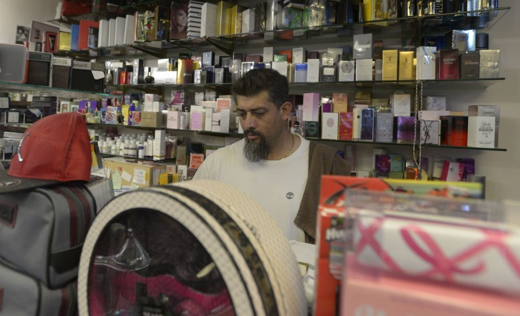 """Ever Castillo, 45, originally from Guatemala, said more Latinos have been coming to Highlandtown from the Fells Point area due to cheaper rents. Overall, he said, life is good for them here. """"The only concern is about the crime. Other than that we have opportunity to live, we have opportunity to have fun ... there's a lot of restaurants. Every weekend is full of people. We are always busy."""" (Christina Tkacik/Baltimore Sun)"""