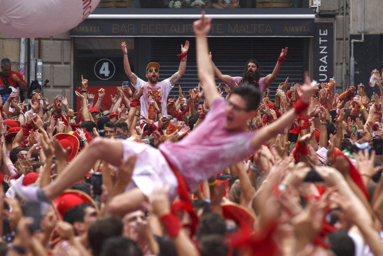 Revellers enjoy the atmosphere during the opening day or 'Chupinazo' of the San Fermin Running of the Bulls fiesta on July 6, 2017 in Pamplona, Spain. The annual Fiesta de San Fermin, made famous by the 1926 novel of US writer Ernest Hemingway entitled 'The Sun Also Rises', involves the daily running of the bulls through the historic heart of Pamplona to the bull ring. (Photo by Pablo Blazquez Dominguez/Getty Images)