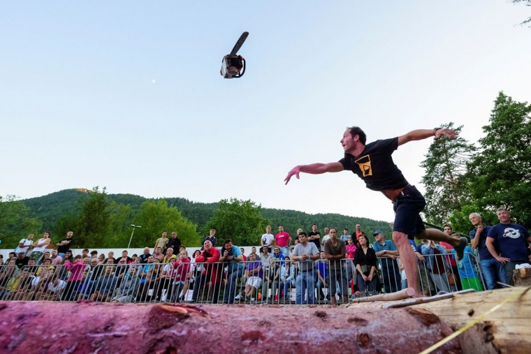 A man competes in the 4th Chainsaw Throw Championship in Kocevje, on July 1, 2017. / AFP PHOTO (JURE MAKOVEC/AFP/Getty Images)