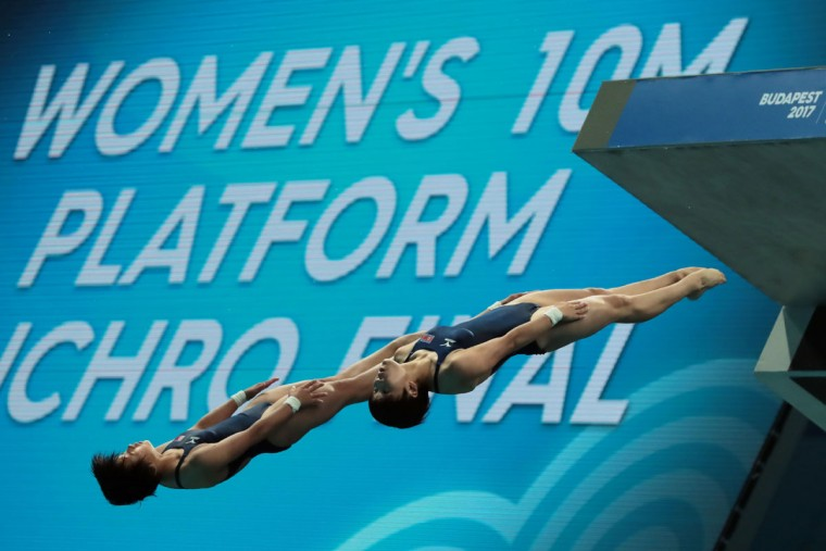 People's Republic of Korea's Kim Mi Rae and People's Republic of Korea's Kim Kuk Hyang compete in the women's 10m platform synchro final during the diving competition at the 2017 FINA World Championships in Budapest, on July 16, 2017. / (AFP Photo/Ferenc Isza)