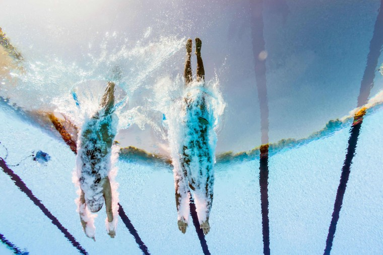 This picture taken with an underwater camera shows Panama's Gabriela Bello Acosta and Panama's Alberto Pinto competing in the Mixed Duet technical final during the synchronised swimming competition at the 2017 FINA World Championships in Budapest, on July 17, 2017. / (AFP Photo/Franáois-xavier Marit)