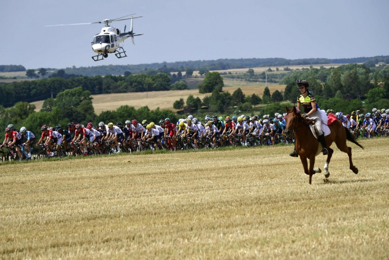 A horse rider is pictured in front of the pack riding as a media helicopter flies over the pack during the 213,5 km seventh stage of the 104th edition of the Tour de France cycling race on July 7, 2017 between Troyes and Nuits-Saint-Georges. (Philippe Lopez/AFP/Getty Images)