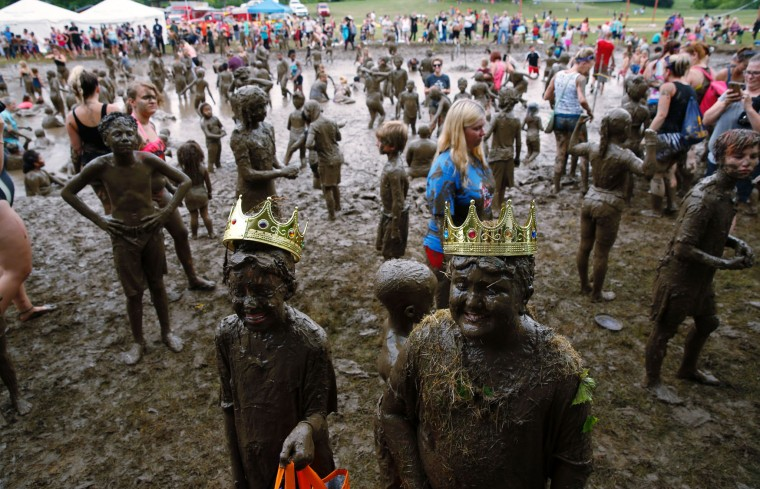 Mackenna Kofahl (L), 12 of Redford and Brian Wilson 10, of Redforn, Michigan smile after being crowned Mud Day Queen and King as part of Wayne County's annual Mud Day at Nankin Mills Park on July 11, 2017 in Westland, Michigan. The mud pit contains 200 tons (181 metric tons) of top soil and 20,000 gallons (75,708 liters) of water. (Jeff Kowalsky/AFP/Getty Images)