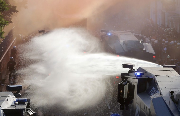 Police uses water cannons during a protest against the G-20 summit in Hamburg, northern Germany, Thursday, July 6, 2017. The leaders of the group of 20 meet July 7 and 8. (AP Photo/Michael Probst)