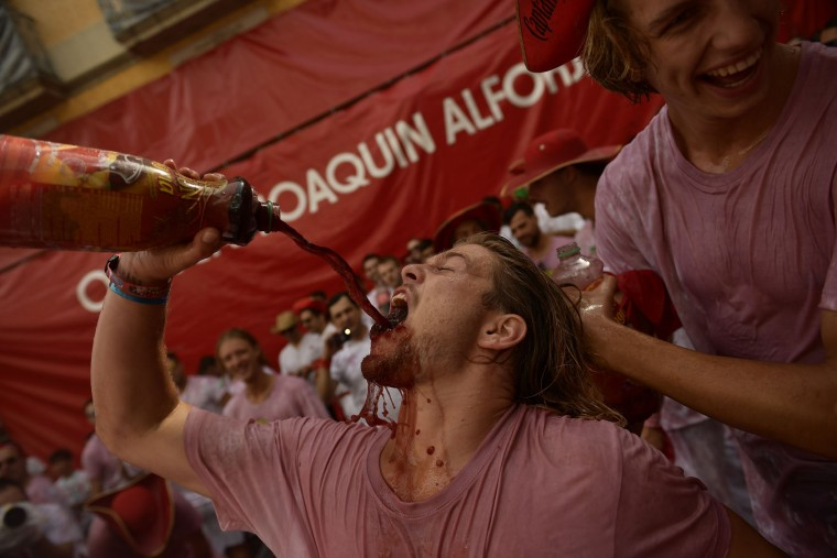 Revellers party during the launching of the 'Chupinazo' rocket, to celebrate the official opening of the 2017 San Fermin Fiestas in Pamplona, Spain, Thursday July 6, 2017. The first of eight days of the running of the bulls along the streets of the old quarter of Pamplona starts Friday. (AP Photo/Alvaro Barrientos)