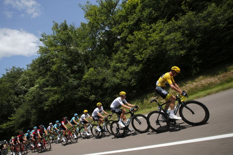 Britain's Chris Froome, wearing the overall leader's yellow jersey, rides in the pack with his Sky teammates during the seventh stage of the Tour de France cycling race over 213.5 kilometers (132.7 miles) with start in Troyes and finish in Nuits-Saint-Georges, France, Friday, July 7, 2017. (AP Photo/Christophe Ena)