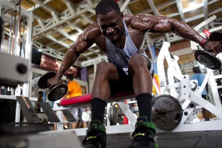 In this July 20, 2017 photo, bodybuilder Spely Laventure trains for an upcoming bodybuilding competition between Haiti and Dominican Republic in Port-au-Prince, Haiti. Laventure could not find a coach when he began training, so he studied YouTube videos and followed bodybuilders on Instagram to learn about the sport and imitate workouts. (AP Photo/Dieu Nalio Chery)